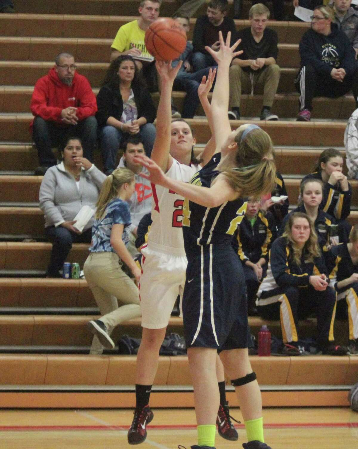 FROM DOWNTOWN: Abby Bretzke energizes the Huskies with an early three ball. (Photo/Robert Myers)