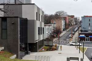 The Capital South Campus Center, left, looking up Philip Street on Monday, Dec. 31, 2018, on Warren Street in Albany, N.Y. First opened in 2014, the education and job-training hub was touted as an entity that would lift South End residents out of poverty and help increase the overall income level in the community. (Will Waldron/Times Union)