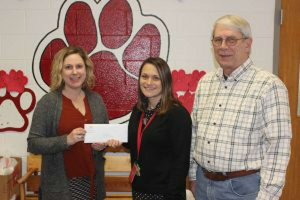 Gina Thornbury presents Betsie Valley Elementary principal Amiee Erfourth (middle) and Skip Comer (right) with a $500 check for Blessings in a Backpack on behalf of the Grand Traverse Regional Community Foundation. (Photo/Robert Myers)