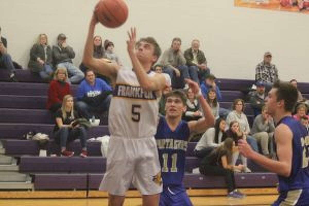 Luke Hammon drives to the basket in Frankfort's victory over Onekama. (Photo/Robert Myers)