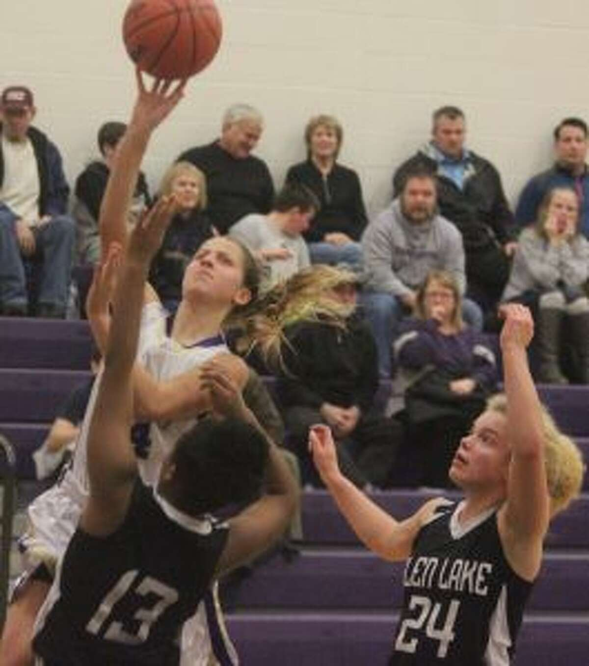 Tara Townsend battles through contact to make a layup and earn a chance at a three-point play. (Photo/Robert Myers)