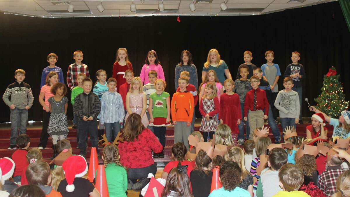 """A JOLLY GOOD TIME: Lake Ann third graders sing """"Have a Holly Jolly Christmas"""" as part of the school Christmas Program on Dec. 22"""