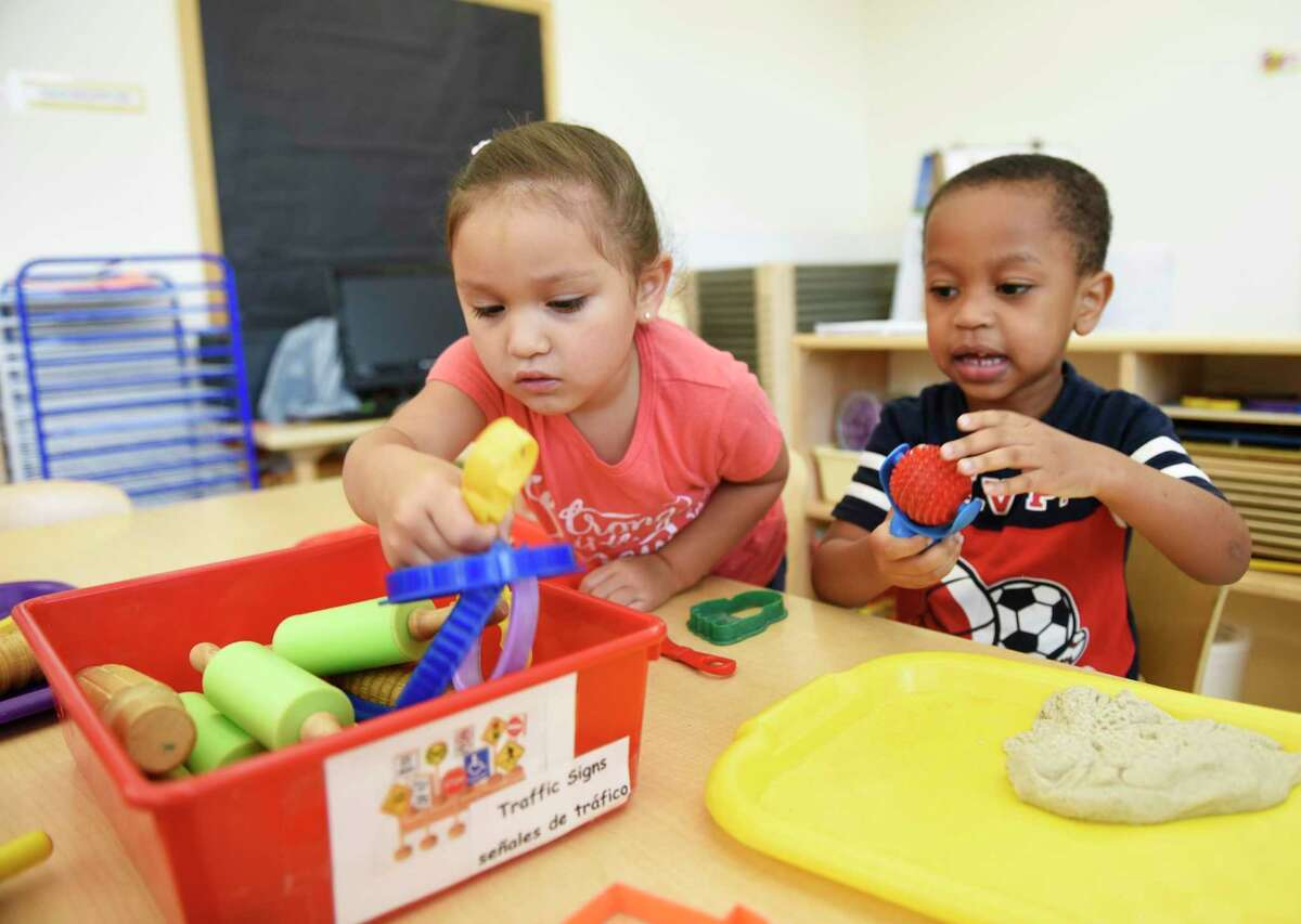 """Preschool students Stephanie A. and Dawnes V. play during preschool welcome week at the Children's Learning Centers of Fairfield County William Pitt branch in Stamford, Conn. Wednesday, Aug. 22, 2018. 169 new students were eased into the school day routine with a two-hour """"transition day"""" on Wednesday, followed by a three and a half hour day Thursday and a six hour day Friday."""