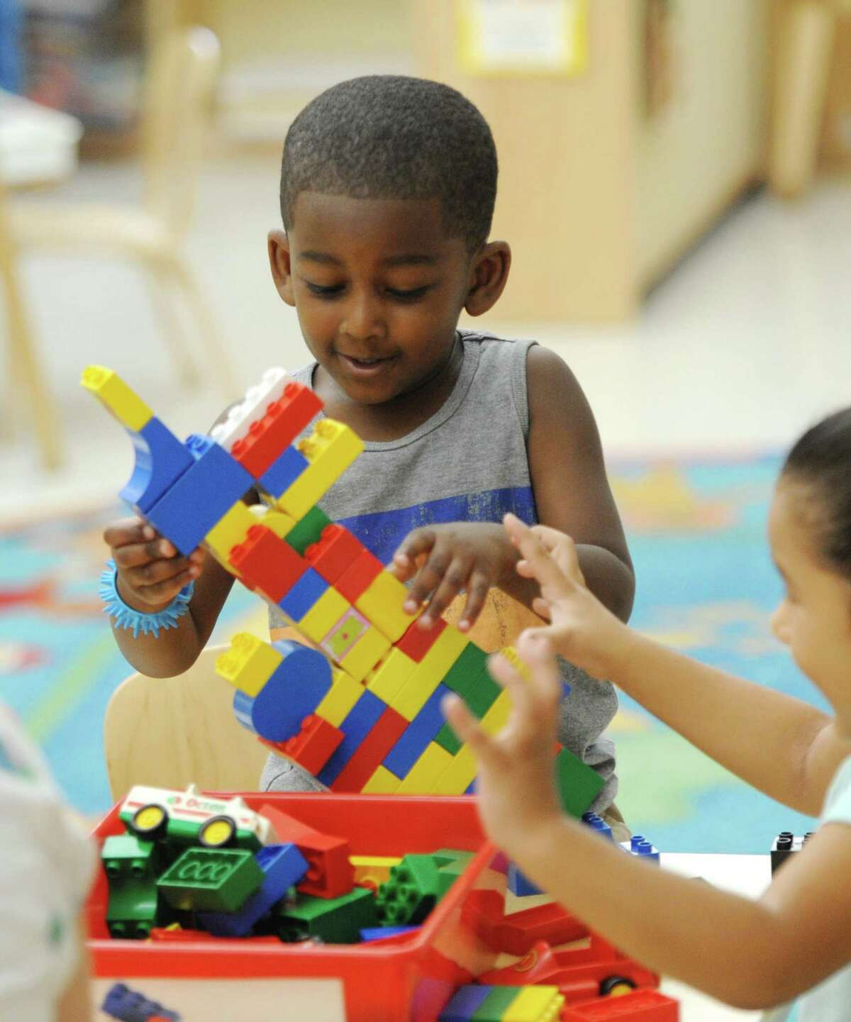 """Preschool students Jeffrey P. and Emma R. build a Lego tower during preschool welcome week at the Children's Learning Centers of Fairfield County William Pitt branch in Stamford, Conn. Wednesday, Aug. 22, 2018. 169 new students were eased into the school day routine with a two-hour """"transition day"""" on Wednesday, followed by a three and a half hour day Thursday and a six hour day Friday."""