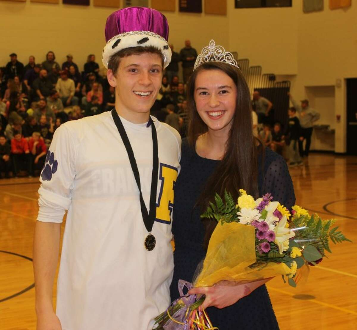THEIR HOUR: Nate Frieswyk and MacKenna Kelly were crowned snowcoming king and queen during halftime of the boys varsity basketball game against Glen Lake on Friday.