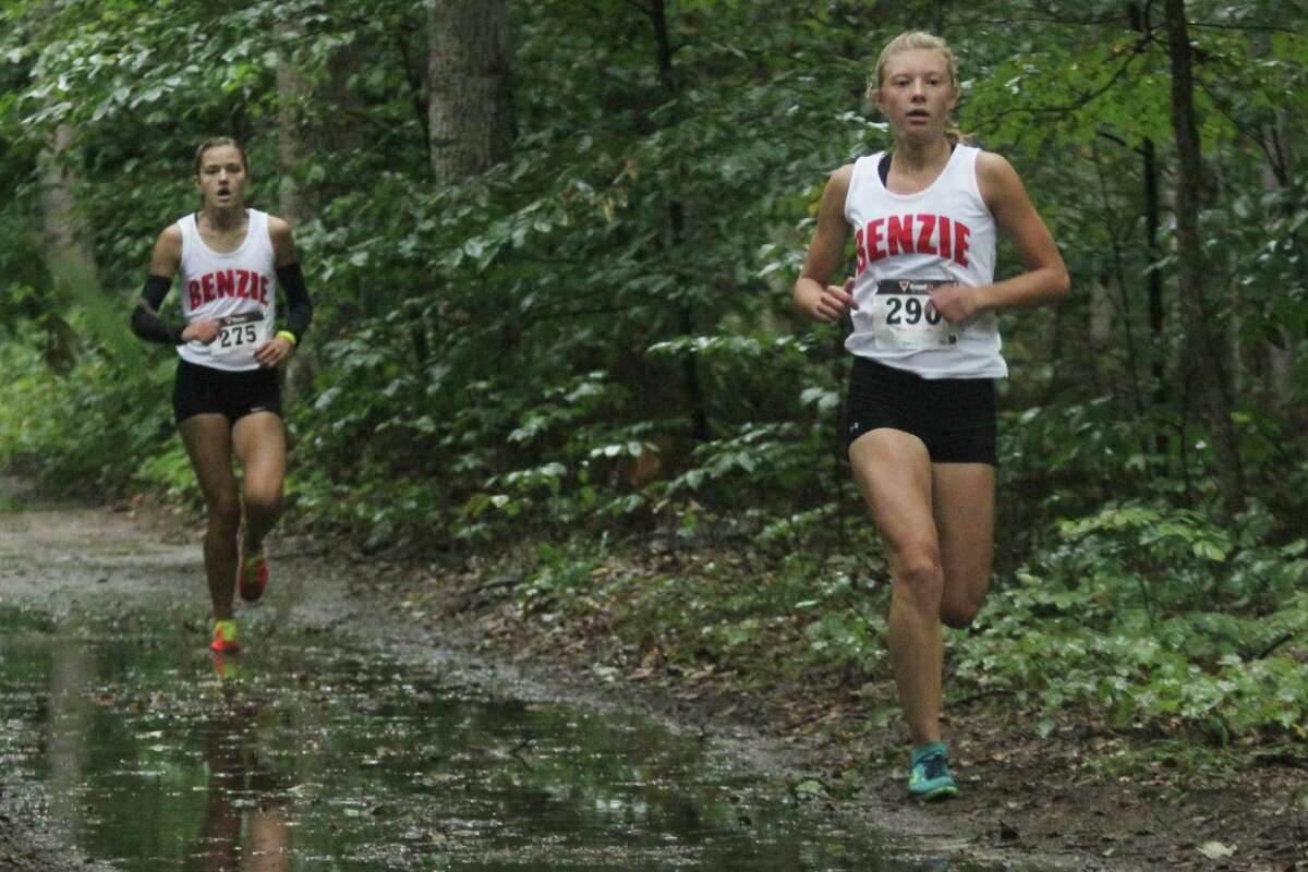 TEARING UP THE COURSE: Sierra Pallin (right) and Olivia Brian (left) race the woods on their way to the sprint to the finish. (Photo/Robert Myers)
