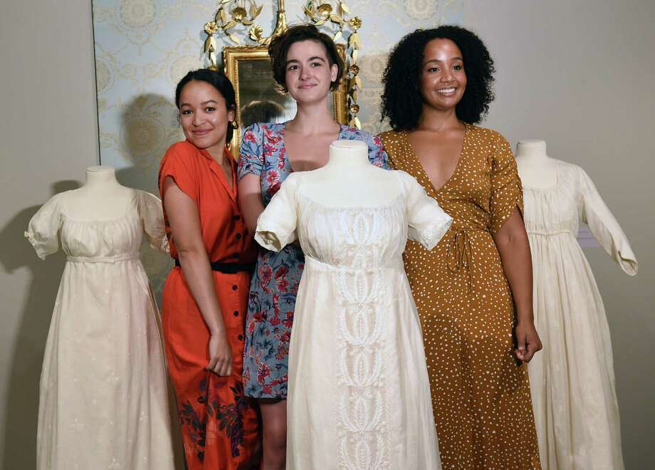 Hamilton cast members, from left, Olivia Puckett (Peggy Schuyler), Hannah Cruz (Eliza Schuyler), and Stephanie Umoh (Angelica Schuyler) pose with the Schuyler Sisters dresses during their visit to the Schuyler Sisters and Their Circle exhibit at the Albany Institute of History and Art on Friday, Aug. 16, 2019 in Albany, N.Y. (Lori Van Buren/Times Union) Photo: Lori Van Buren, Albany Times Union / 20047663A