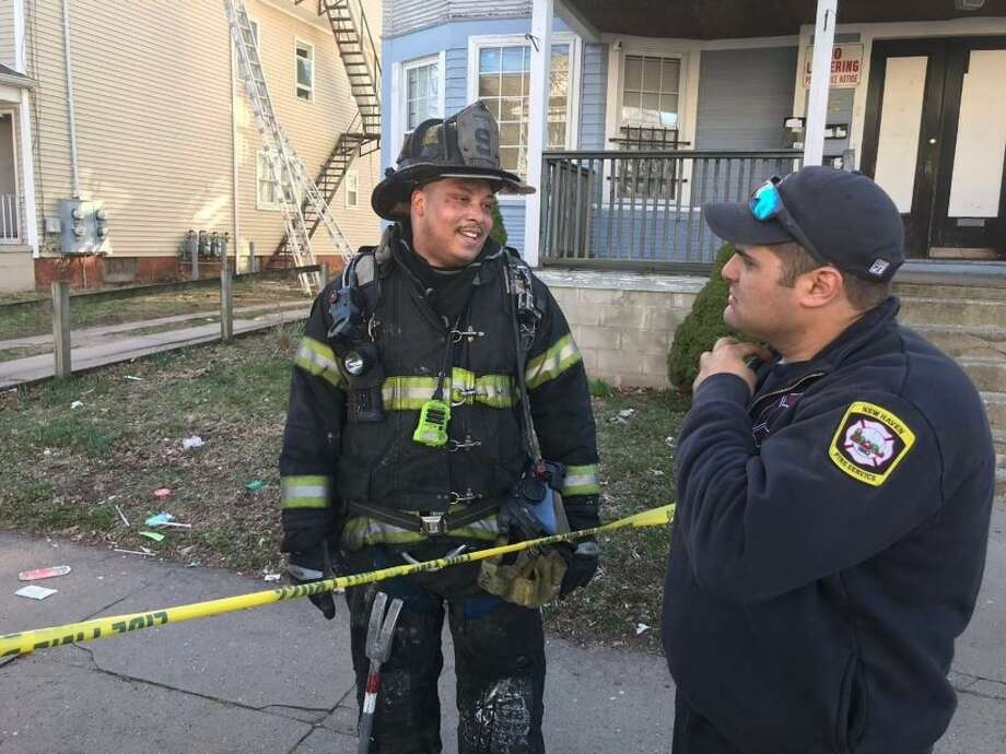 New Haven Fire Lt. Leon Brown, left, shown in this photo from a different incident, rushed to help shooting victims on Henry Street on August 12. Photo: Contributed /