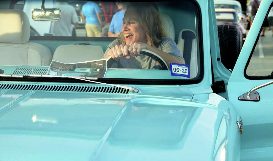 After she was presented with her late father's Chevy pickup in a surprise that took almost a year to hatch, Donna wasted no time trying out the driver's seat. Photo: Jeff Yip / Jeff Yip