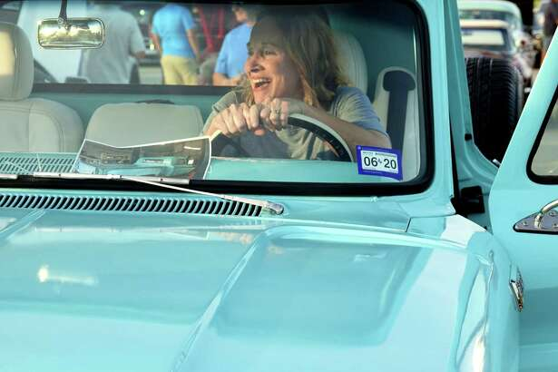 After she was presented with her late father's Chevy pickup in a surprise that took almost a year to hatch, Donna wasted no time trying out the driver's seat.