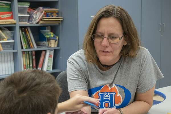 Stacey Hudson works with her students 08/16/19 in her life skills class at Henderson Elementary. Tim Fischer/Reporter-Telegram
