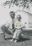 Henry J. Kuiper with son Duane on the family farm in Racine, Wisc.