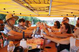 Brew Boat participants cheers during a recent trip on the Sacramento River.
