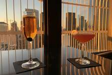 Smith Tower Observatory Bar Mon-Thurs 4-6 p.m.; American ($12 observatory tickets, $9 food and cocktails)