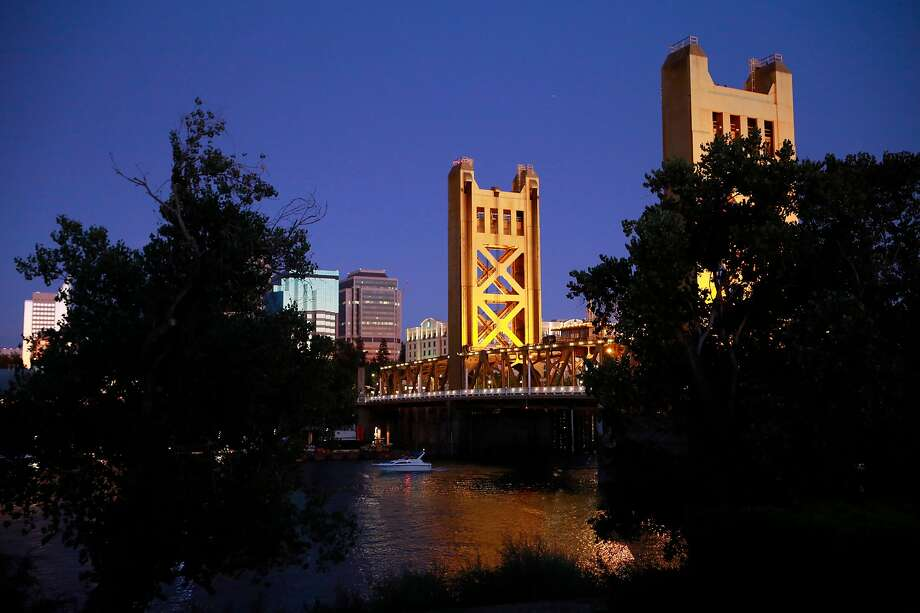 The shimmery-gold Tower Bridge over the Sacramento River near Old Sacramento. Photo: Michael Macor / Special To The Chronicle
