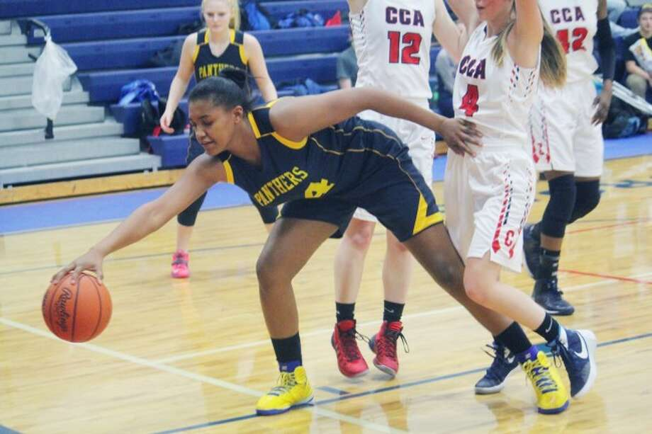 victory: Baldwin's Amanyi Freeman tries to secure the ball in Thursday's game at CCA. (Star photo/John Raffel)
