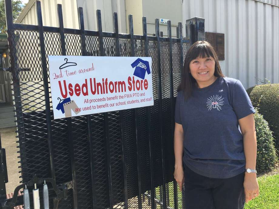 When the sign is posted on the gate, parents at Faith West Academy know that The Uniform Store that resells donated clothing is open, said Amy Abels, PTO president. Photo: Karen Zurawski / Karen Zurawski