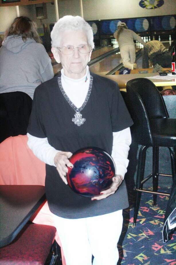 LOVE FOR THE GAME: June Davis gets ready for another bowling season at Baldwin lanes. (Star photo/John Raffel)