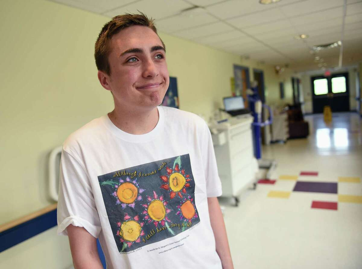 CBA Sophomore Gabriel Donovan wears a t-shirt displaying his artwork as he visits