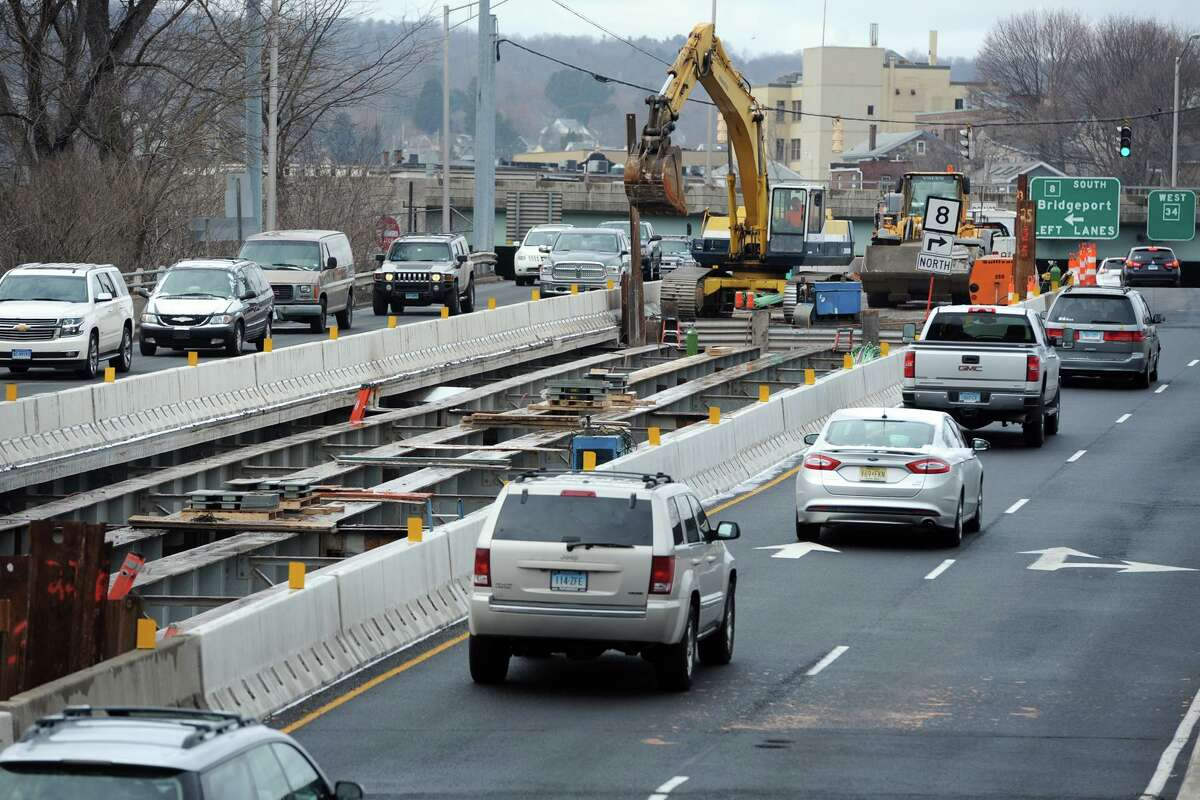 Traffic travels through the construction zone on the Main Street (Rt. 34) bridge, over the Naugatuck River, seen here looking toward downtown Derby.