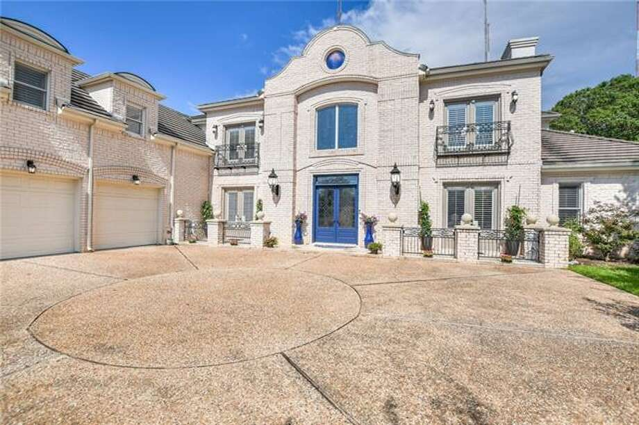 This Austin home at 2815 Waterbank is under foreclosure with a list price of $1.97 million. Photo: Houston Association Of Realtors
