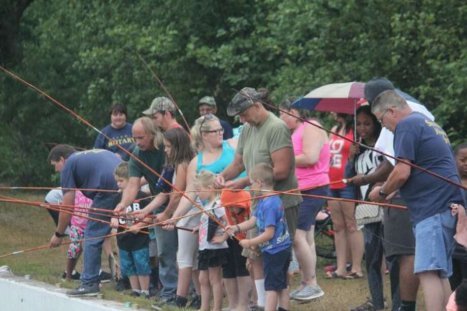 Youngsters compete in fishing derby.