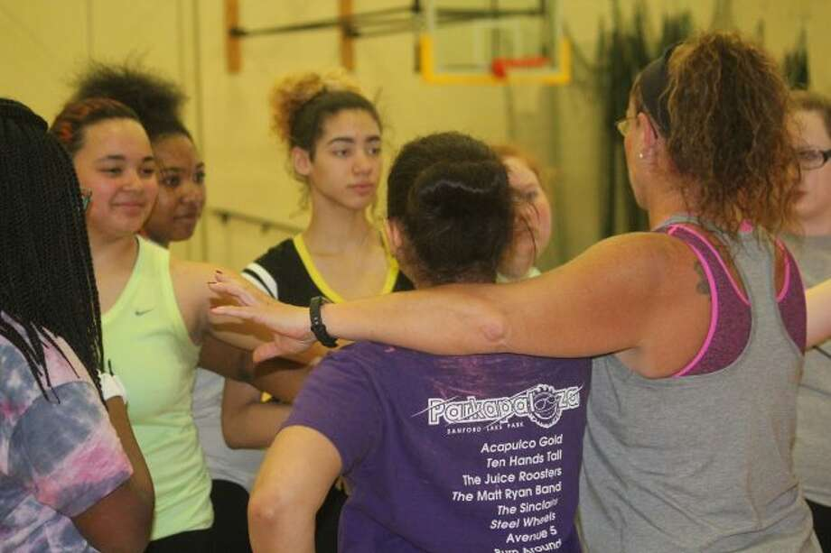 Baldwin's softball team meets after a practice.