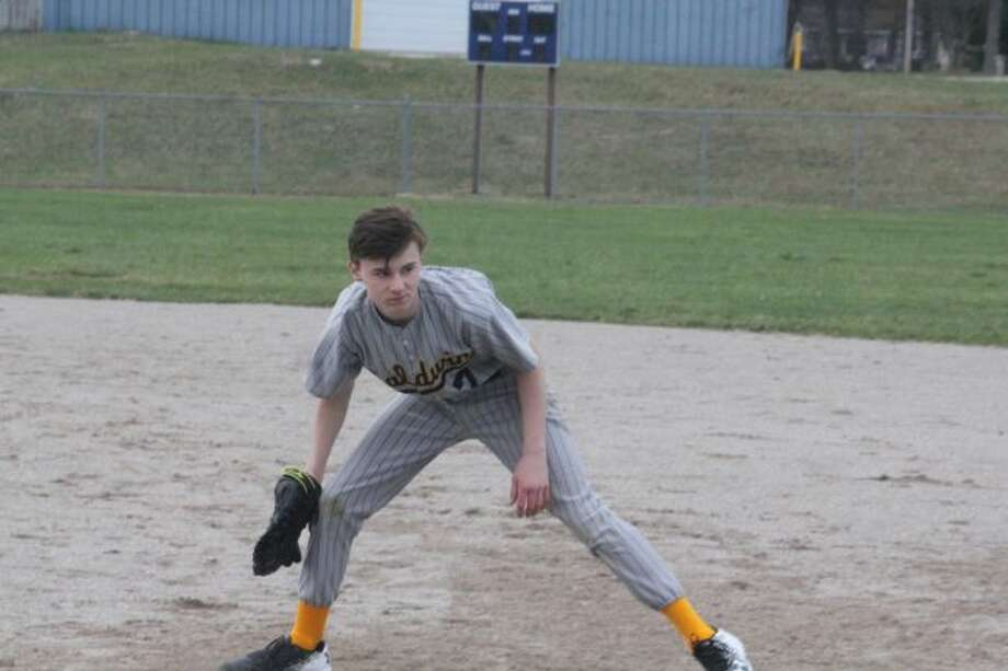 Baldwin's Spencer Sabin looks to make the play at first base.