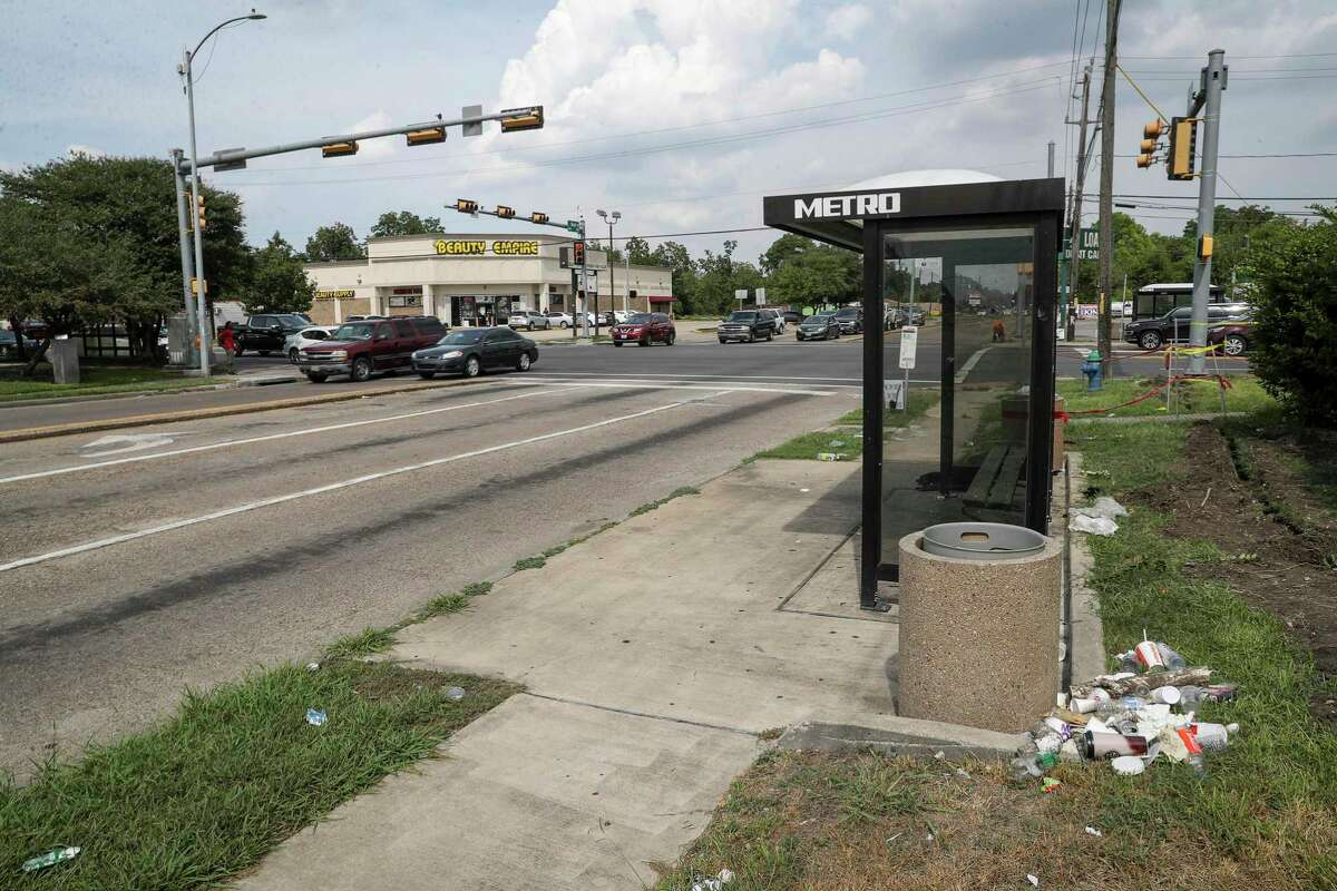 Trash sits on the ground at a bus stop at Reed Road and Cullen Boulevard on Aug. 15, 2019, in Houston. Metropolitan Transit Authority will triple its spending on cleaning and maintenance of stops so every stop is addressed, under a plan awaiting approval.