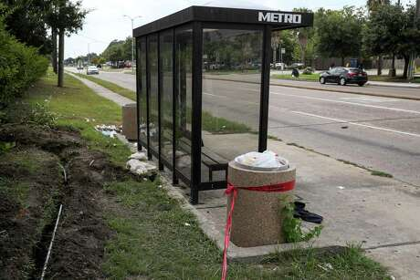 Trash sits on the ground at a bus stop at Reed Road and Cullen Boulevard on Aug. 15, 2019, in Houston.