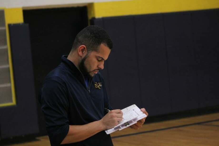 Baldwin volleyball coach Duane Roberts looks at his notes.