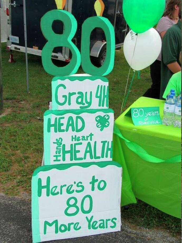 A sign by Gray 4-H's Pop Stand highlights the club's 80th anniversary. (Victoria Ritter/vritter@mdn.net)
