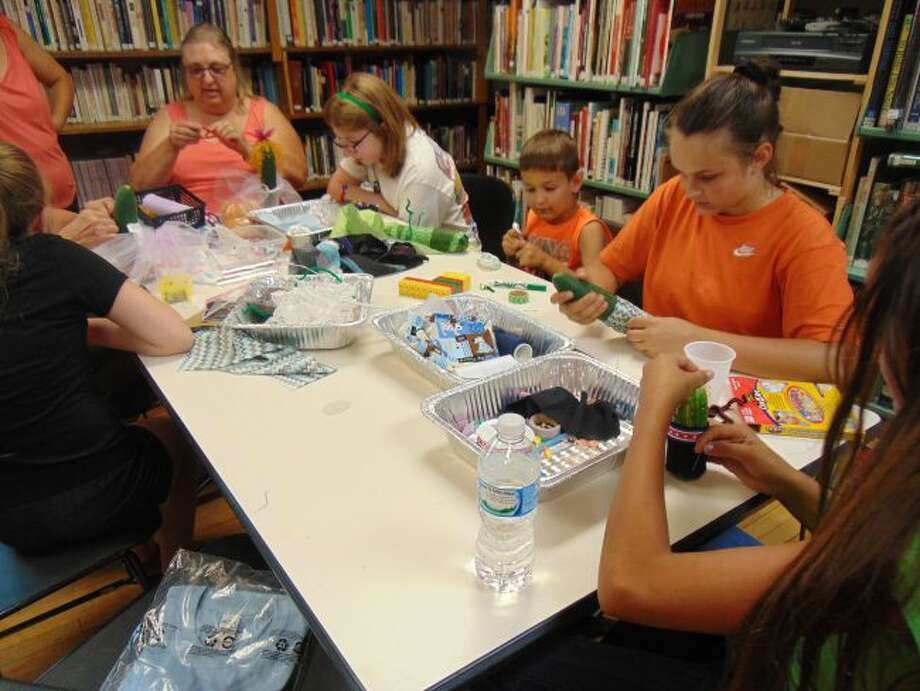 Families came together for a picnic and other activities at Chase Township Public Library during the end of the summer reading program party.