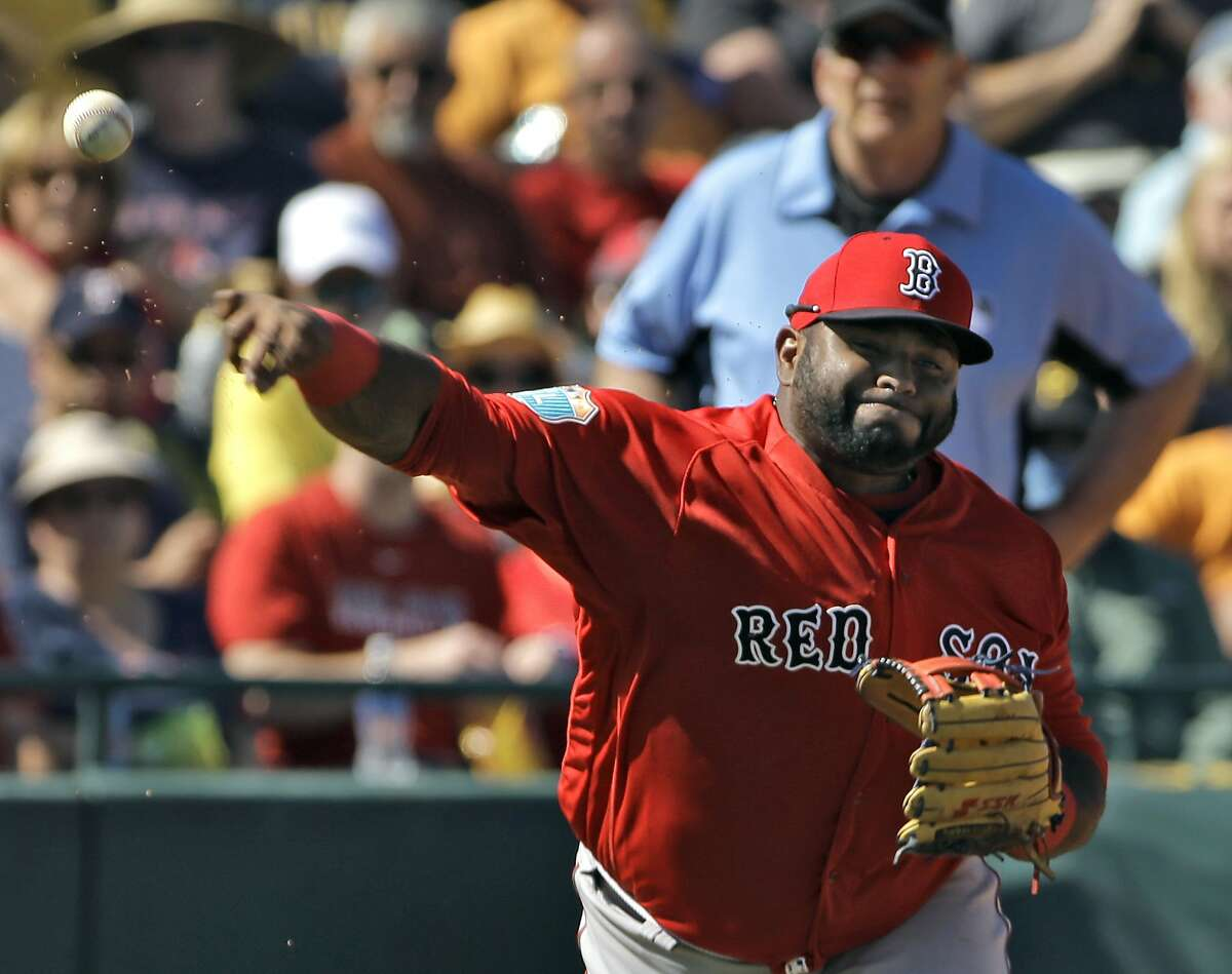 Boston Red Sox third baseman Pablo Sandoval throws out Pittsburgh Pirates' Cole Figueroa after making a diving stop at third during the fifth inning of a spring training baseball game Wednesday, March 9, 2016, in Bradenton, Fla. (AP Photo/Chris O'Meara)
