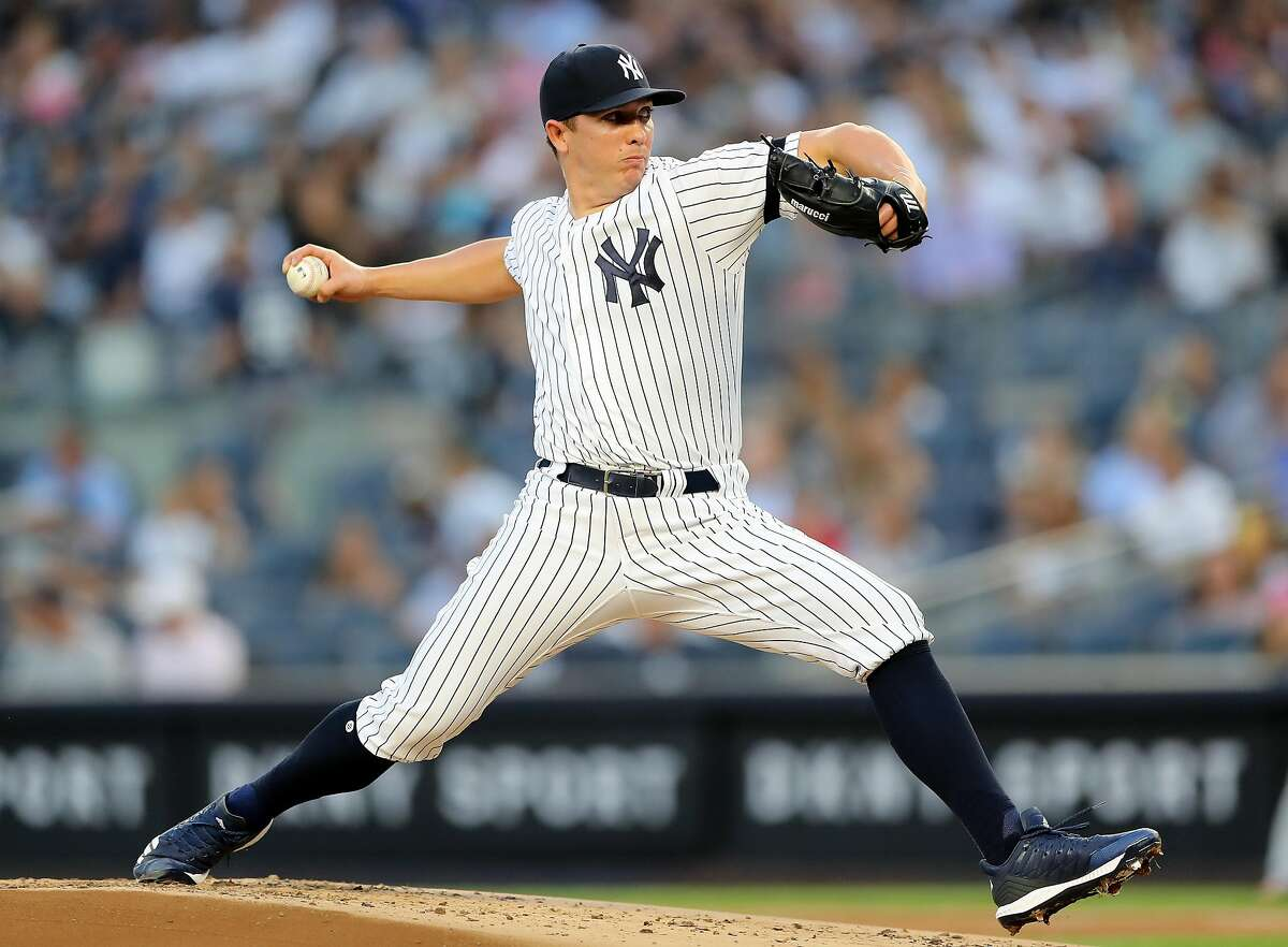 NEW YORK, NEW YORK - AUGUST 15: Chad Green #57 of the New York Yankees delivers a pitch in the first inning against the Cleveland Indians at Yankee Stadium on August 15, 2019 in the Bronx borough of New York City. (Photo by Elsa/Getty Images)
