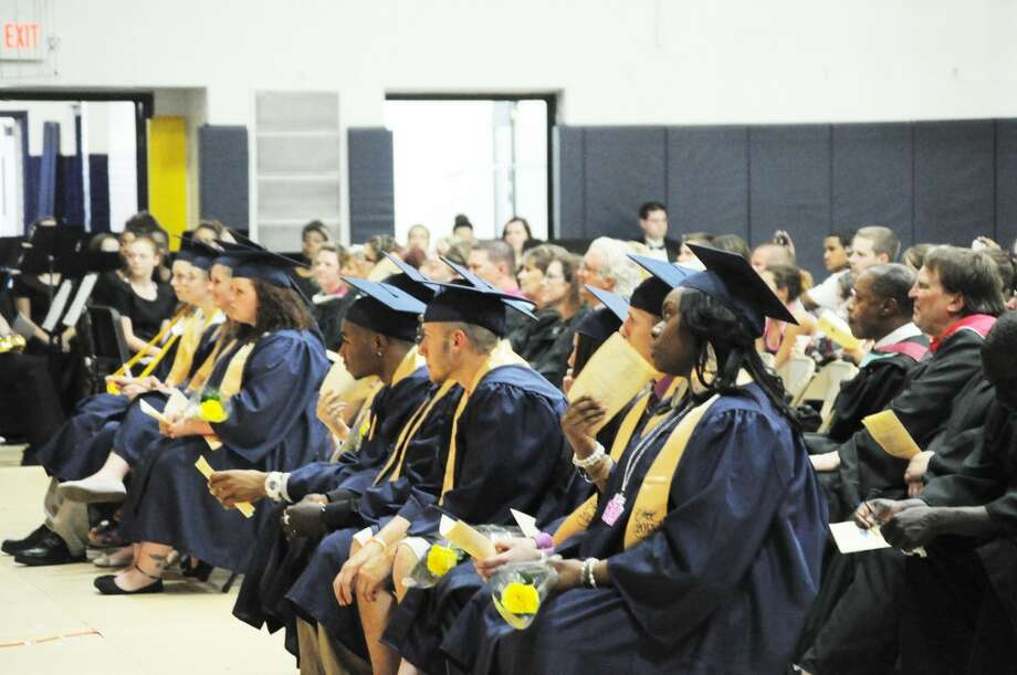CLASS OF 2013: Sitting together in the front row of the Baldwin High School gym is the graduating Class of 2013. The commencement ceremony included speeches, a slide show and a rendition of the class song by a classmate. (Star photo/Kyle Leppek)