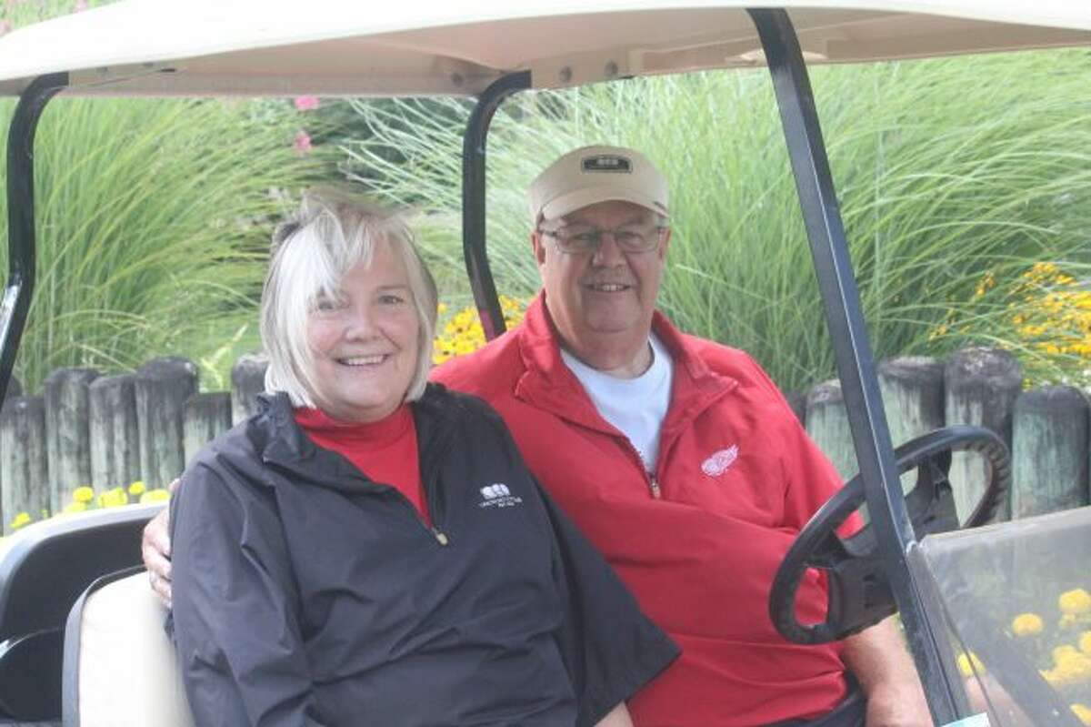 Tom and Pat Ackerberg are set for a round of golf.