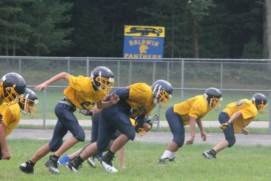 Baldwin football players get ready during a practice.