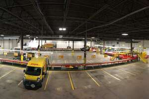 A view inside of DHL Express' West Hartford service center. The facility  recently was expanded and outfitted with state-of-the-art equipment so it can handle twice as many inbound packages from countries around the world.