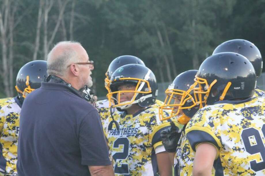 CoachMark Zajack and Baldwin players confer after a game.