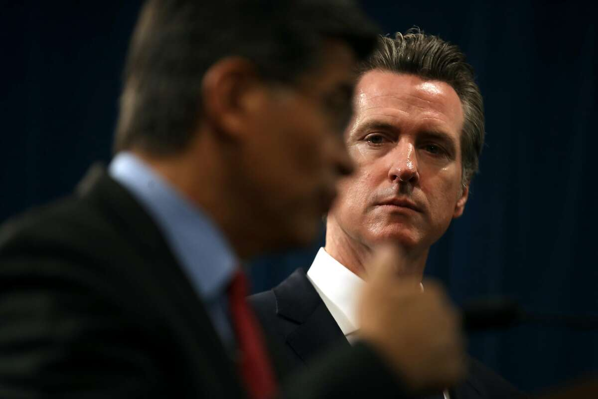SACRAMENTO, CALIFORNIA - AUGUST 16: California Gov. Gavin Newsom (R) looks on as California attorney General Xavier Becerra (L) speaks during a news conference at the California State Capitol on August 16, 2019 in Sacramento, California. California attor