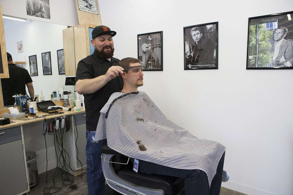Scenes of daily work and life at Facebook, Inc. USA Headquarters in Menlo Park, California. A barber shop on campus is one of the many perks offered to employees at Facebook. (Photo by Kim Kulish/Corbis via Getty Images)