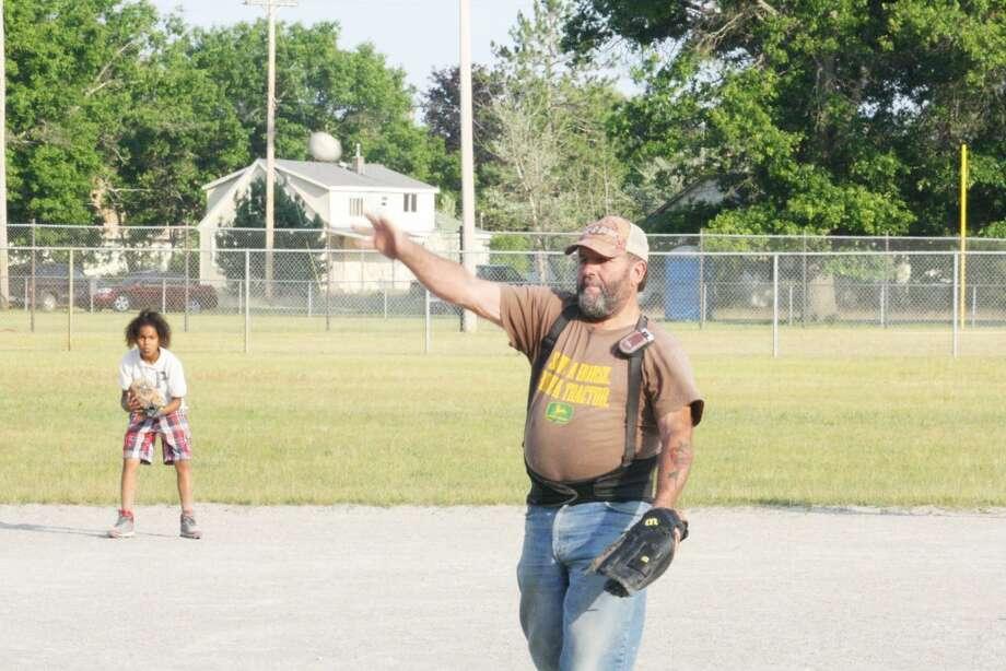 Up to bat: Baldwin Little League coach Bill Buckley delivers batting practice on Monday. (Star photo/John Raffel)