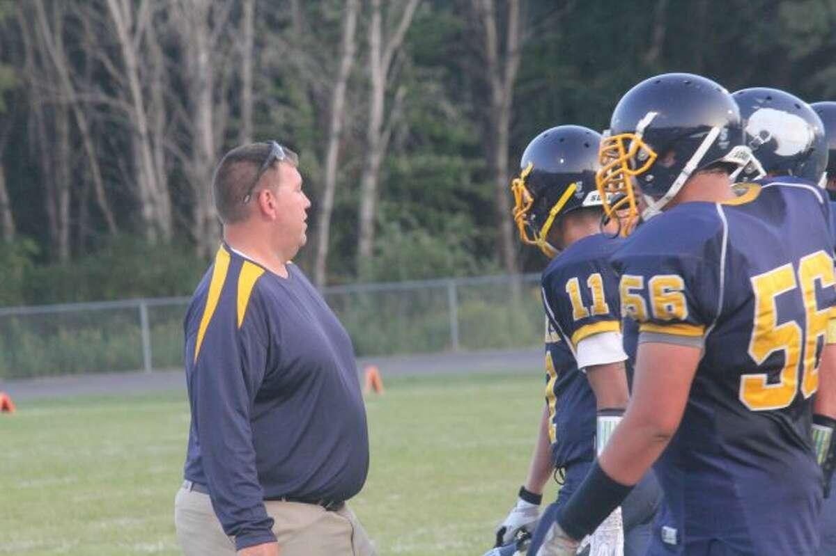 Baldwin assistant coach Scott Pedigo talks to his defense.