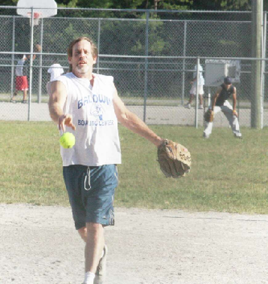 Tournament: Nick Miller makes a pitch in last year's Baldwin Men's Softball League. There is no league this season but Baldwin will still host the Troutarama and Labor Day tournaments. (File photo)