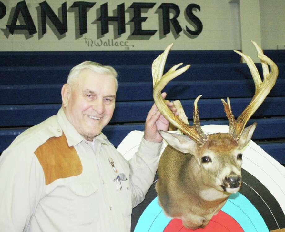 Target practice: Lake County Sportsman Club member Bob Myers has a 15-target archery setup at his rural Baldwin property. (File photo)
