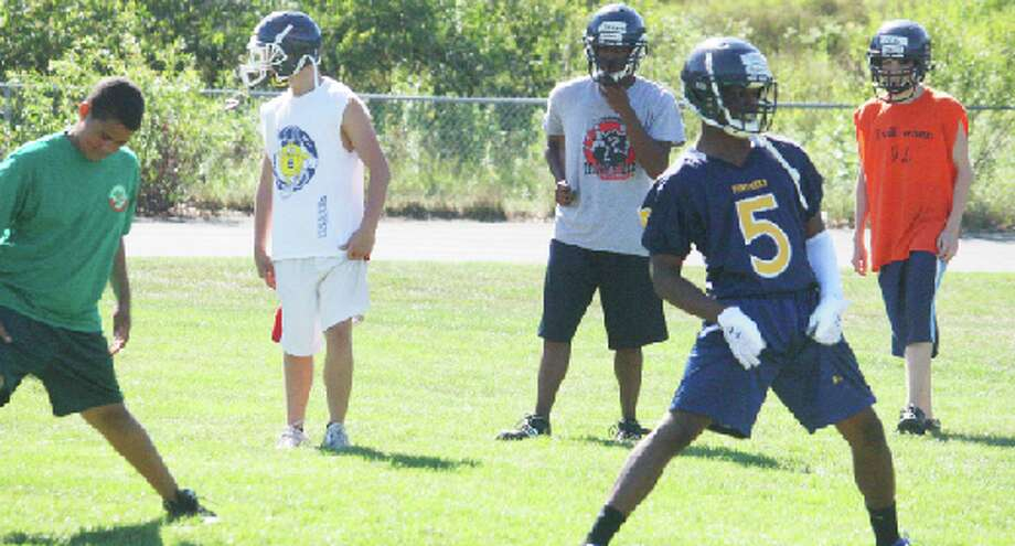 Conditioning: Baldwin football players, pictured here at the 2012 preseason practices, are now in weight-lifting and conditioning sessions, getting ready for the season. (File photo)