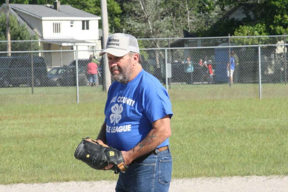 Practice: Baldwin Little League coach Bill Buckley works with his team during practice this season. (File photo)