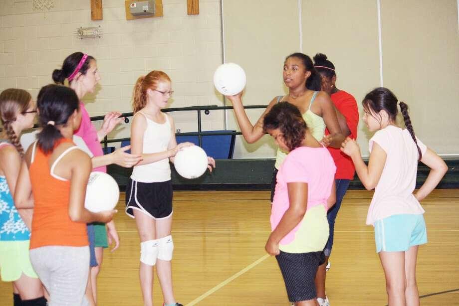 Volleyball: Baldwin volleyball girls meet with Antoinette Yiberhu at last week's camps. (Star photo/John Raffel)