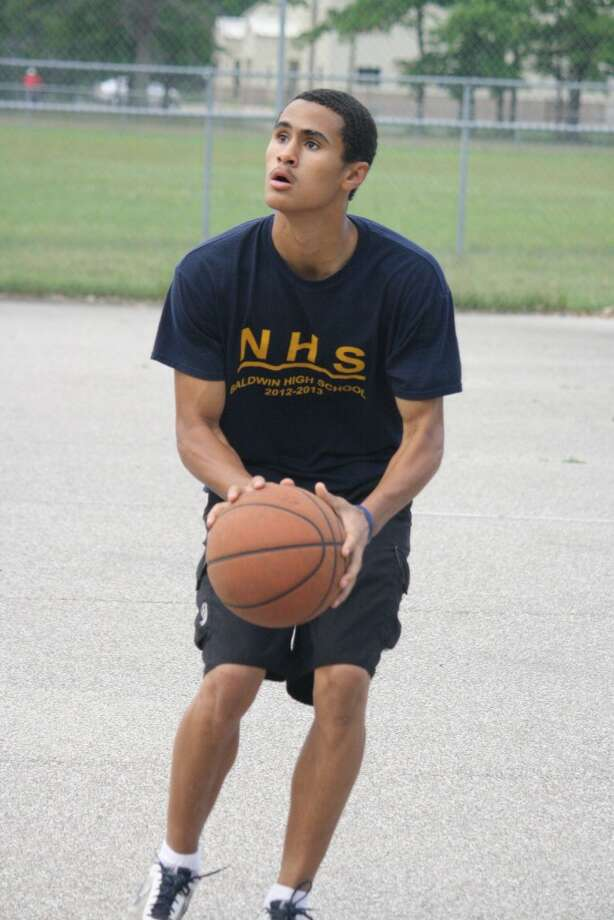 Chosen: Brandon Childress became the first player from Baldwin selected to participate in the fifth annual reaching higher showcase of Michigan's top high school basketball players. The camp returned to South Lyon High School beginning with the boys event this week.